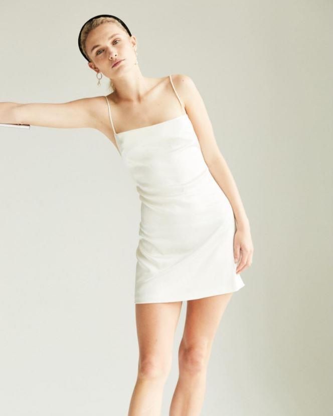 "**The Mini Slip:** Much like its longer sister, a mini slip is the minimalist's ideal reception outfit, particularly when paired with a sleek slide or strappy sandal. Plus, it's perfect for a summer wedding. <br><br> *Paris Georgia dress, at [Paris Georgia](https://shop.parisgeorgiastore.com/collections/all-products/products/samara-slip|target=""_blank""
