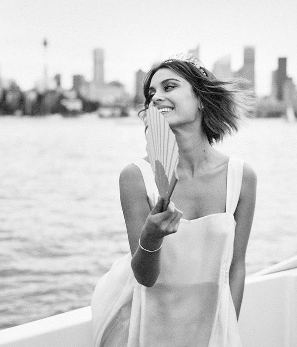 """**On the dress:** <br><br> Two weeks after the proposal, I had a weekend off from filming, so I flew to New York. At first I didn't want an engagement ring because I thought it was a waste of money and a status symbol, which I'm against, but then I thought about it and said to Jordy, """"You know, it's going to look really bad when I don't have a ring and you have to keep explaining why.""""  <br><br> Jordy let me pick my ring because I'm very specific, and I went to my favourite jewellery designer, Wendy Nichol. When I visited her New York boutique, I noticed she had dresses in there, too—she's an amazing dress designer. <br><br> I love that the pieces are made to order and nothing is mass-produced. I saw this one dress that was kind of like a pinafore silhouette, with a low draping back. I can imagine that on the runway it could have had a more gothic vibe and been styled with black boots and dark lipstick, but I saw it and thought, This could actually be a wedding dress. <br><br> I tried it on—it was the first wedding dress I ever tried on—then I tried two more of her designs. But I decided on the first one on the spot. It was kind of like how I decided about Jordan. I was like, You know what? I'm here right now, so I'm just going to go with my gut. And I loved the idea of not having to spend the next six weeks searching for the perfect dress. <br><br> I trusted in the timing and the synchronicity of everything. I love the dress so much because, as somebody who had never dreamed about her wedding, I had to decide pretty quickly how I wanted to look and feel on the day.  <br><br> I thought, Who do I want to embody? Is it someone with a restricted energy in a tight dress who isn't totally approach-able? No, not really. I wanted to be comfortable, and this dress, to me, was the embodiment of innocence and purity and light and simplicity. It was also all the ways I would describe my relationship: uncomplicated, unfussy, open, easy to read—what you see is what you get. That"""