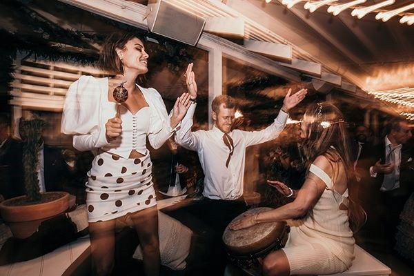 **On the entertainment:** <br><br> Everyone was so hyped and jumping around, shaking the maracas in the air and singing along. It was like we were casting love spells over the harbour, and everyone was so high from the love in the room—it was an indescribable feeling.