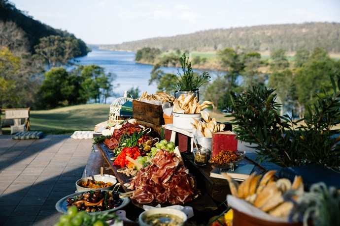 **On the food:** The caterers were locals from the Kangaroo Valley, and they really worked with our brief. We wanted the best of both a standing and seated wedding, so entrees were served on roaming platters alongside a antipasti grazing table and a live oyster shucker (@jimwildsoysterservice). Guests were then seated for a shared dinner menu that included slow cooked lamb shoulder and hickory hot smoked salmon, and then everyone was back up again for dessert, which included (my favourite!) mini lemon tarts. It was a long day and we anticipated people would get hungry again after hours of dancing, so we arranged a midnight snack in the form of a maple glazed ham served with house baked rolls, cheddar, pickles, and mustard.