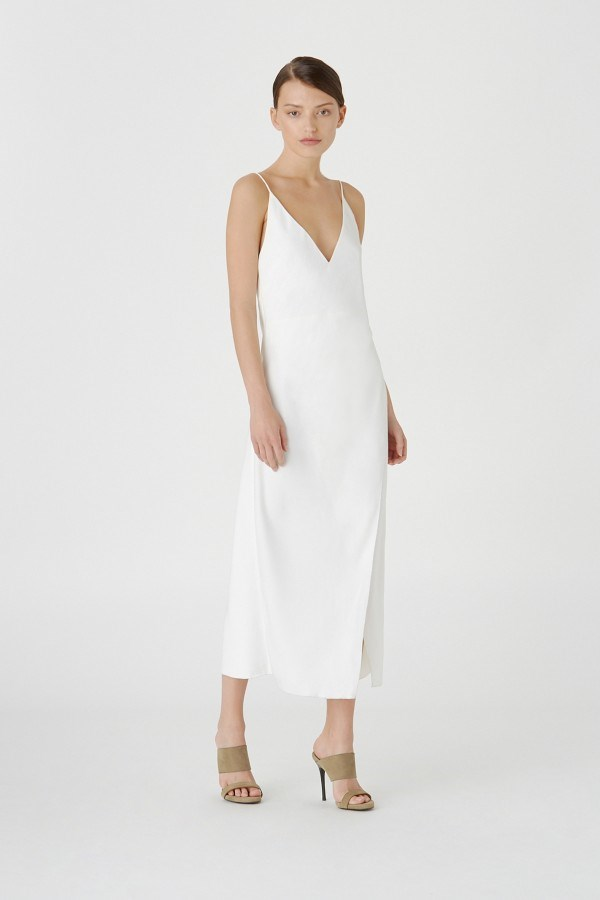 "**The Long Slip Dress:** A classic since Carolyn Bessette Kennedy wore a Narciso Rodriguez version to wed John F. Kennedy Jr in 1996, a slip dress is the ultimate in easy, breezy post-wedding wear. Choose the right version and it can take you straight from your wedding reception to beachfront cocktails on your honeymoon. <br><br> *Camilla & Marc Amaral slip dress, $599, at [Camilla & Marc](https://www.camillaandmarc.com/amaral-slip-dress-white.html?gclid=CjwKCAiAo8jgBRAVEiwAJUXKqOWqbhBsWh3io-2QLh8zzAx0PHSoRxQBHSJgcc53OusEdzBLeZgtsRoC97UQAvD_BwE&gclsrc=aw.ds#|target=""_blank""