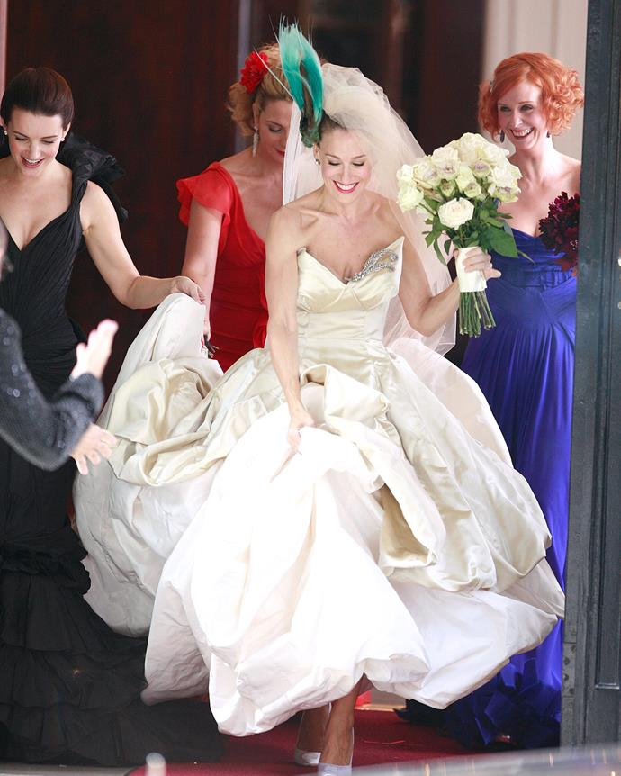 ***The Vivienne Westwood wedding dress*** <br><br> No matter your thoughts on Carrie's Westwood gown for her ill-fated wedding in the first *SATC* film, you can't deny how quintessentially *Carrie* it is. It also features many of Vivienne Westwood's trademark design characteristics, including whimsical, borderline brash tailoring and nods to the history of British 'punk' culture that the designer is is synonymous with.