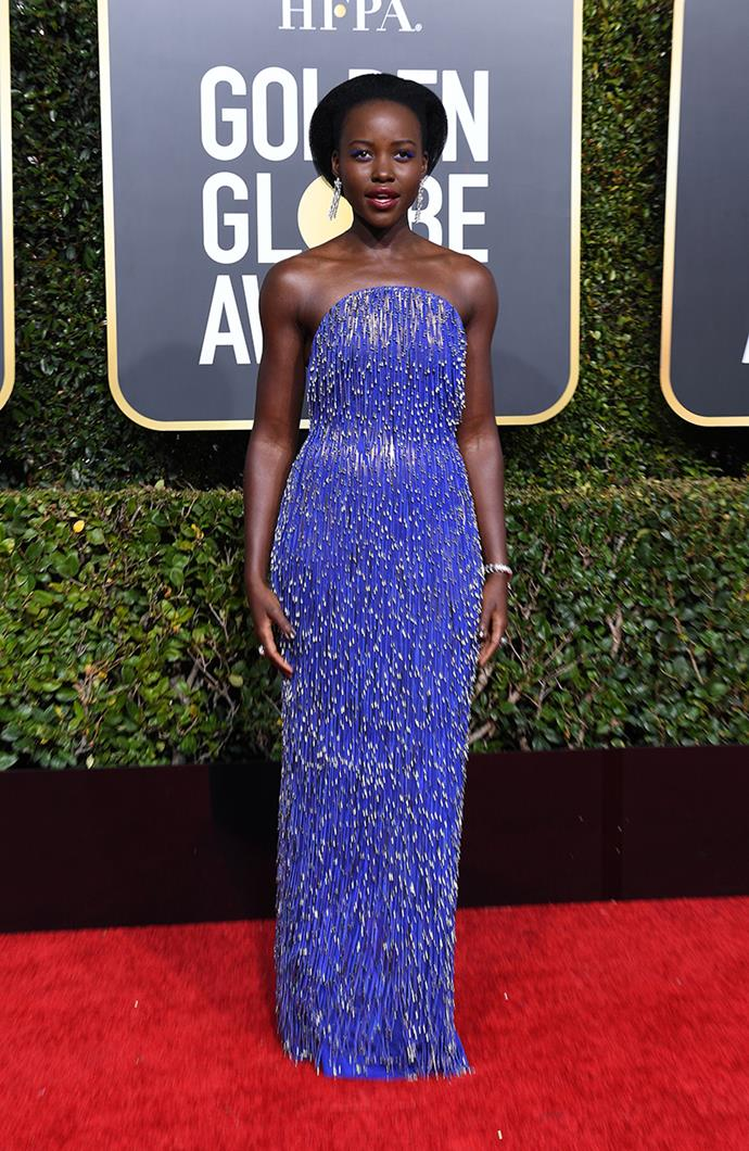 "**Lupita Nyong'o in Calvin Klein by Appointment**<br><br> ""This colour should be renamed 'Lupita' as nobody can or ever will wear it as well as she does."" *Kate Lancaster, beauty writer.*<br><br> ""The simple silhouette ensures the glitz of the dress is juuust right, and when paired with simple accessories it really does pop."" *Samantha Wong, market editor.*<br><br> ""Lupita crushes it every time. So pleased to see she went with a colour that just POPS with her skin. The girl is a goddess and can do no wrong in my eyes."" *Kate Sullivan, senior editorial coordinator.* <br><br> ""Lupita Nyong'o never puts a foot wrong—this cobalt Calvin Klein by Appointment look is impeccable."" *Grace O'Neill, fashion features director.*"