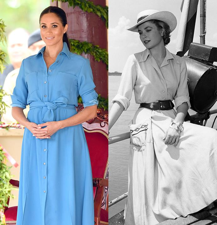 In a belted shirt dress with rolled sleeves.