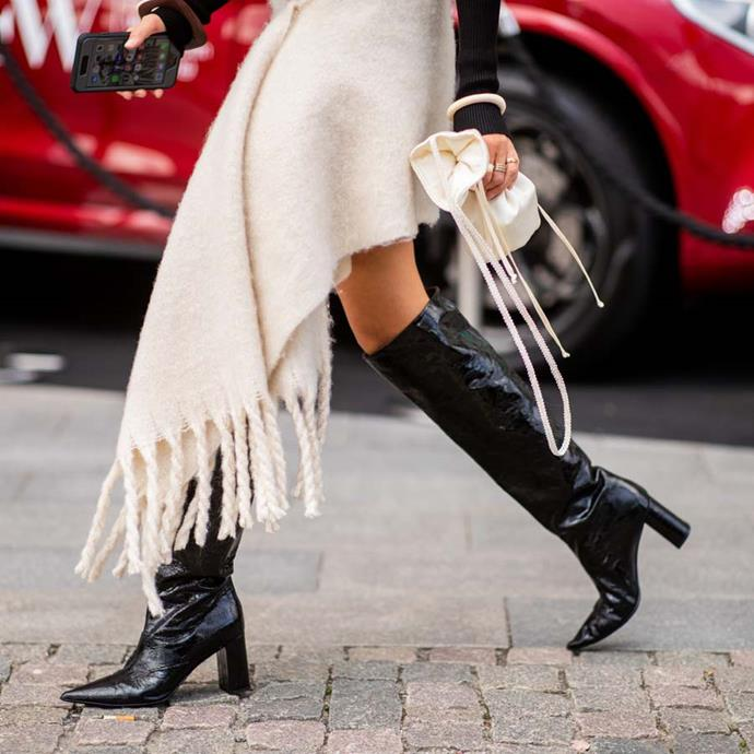 """*A pair of slouchy boots*<br><br> While we wouldn't quite recommend going the [Rihanna way of things](https://www.instagram.com/p/BhmfiJiDsC8/ target=""""_blank"""" rel=""""nofollow""""), slouchy boots are making a '90s-shaped comeback, says market editor Samantha Wong.<br><br> """"Make sure it's just below the knee, and they're roomy enough to scrunch down. Worn best with a mini-skirt and bare legs."""""""