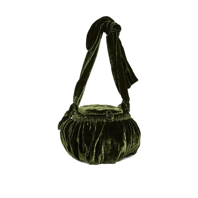"*A velvet bag*<br><bR> Bag by Cult Gaia, $278 at [Shopbop](https://www.shopbop.com/joana-sewing-bag-cult-gaia/vp/v=1/1587251444.htm|target=""_blank""|rel=""nofollow"")."