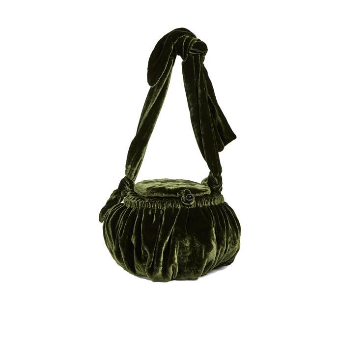 "*A velvet bag*<br><bR> Bag by Cult Gaia, $278 at [Shopbop](https://www.shopbop.com/joana-sewing-bag-cult-gaia/vp/v=1/1587251444.htm target=""_blank"" rel=""nofollow"")."