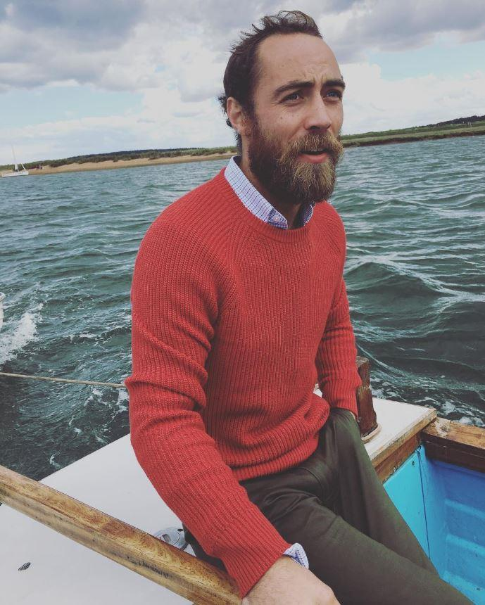 Wearing a classic fisherman's sweater on a rowboat.