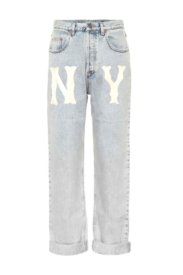 """*Acid Wash*<br><Br> Jeans by Gucci, $1,530 at [My Theresa](https://www.mytheresa.com/en-au/gucci-ny-yankees-straight-leg-jeans-1074654.html target=""""_blank"""" rel=""""nofollow"""")."""