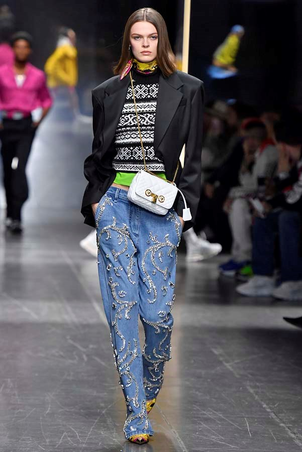 *Embellished*<bR><br> Feathers, sequins, ribbons and jewels. Why should your dresses get all the fun? Luxe add-ons for jeans are the ultimate way to upgrade them to cocktail status.<br><br> As seen at: Versace.