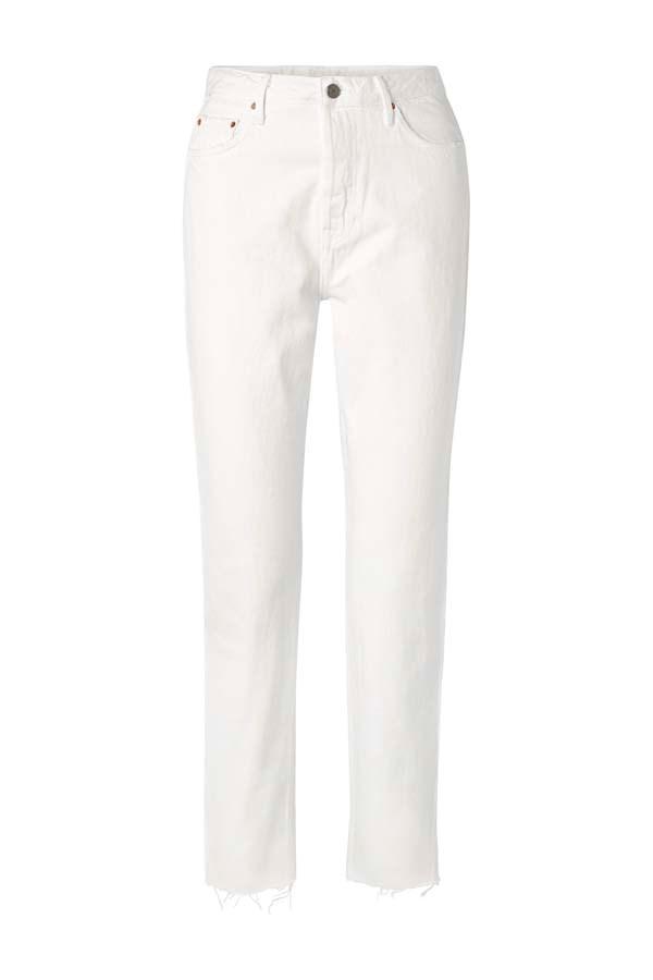"*White Hot*<br><br> Jeans by GRLFRND, $296 at [NET-A-PORTER](https://www.net-a-porter.com/au/en/product/1111441/grlfrnd/devon-frayed-high-rise-straight-leg-jeans target=""_blank"" rel=""nofollow"")."