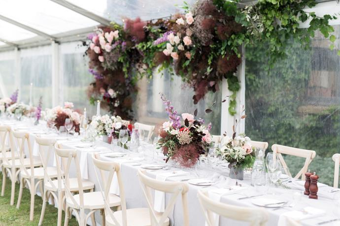 **On the style of the reception:** With an open brief to create a romantic, European, elegant feel for our reception Weddings of Desire did the most outstanding job. It would not have looked or been as magical without Laura, whose vision is what fairy tales are made of. She created an intimate, candle lit setting in a clear marquee that stood next to the sandstone house on the property. Covered in lush green vines, the house was the perfect backdrop and exuded European elegance. Chandeliers hung from the marquee ceiling that was filled with fairy lights. Textured linen dressed the tables with layers of chiffon cascading down the centre, mimicking the layers of tulle in my dress. Candles lined the tables and floral installations and arrangements filled the marquee with warmth and whimsy. We also had stunning menu and name placements that were tied with ribbon and a wax seal