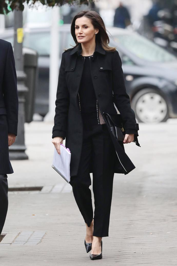 In a cut-out netted blouse and matching black overcoat on 17 January, 2019.