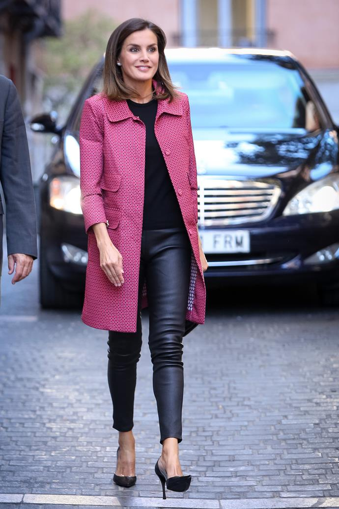 In a fuchsia coat and leather trousers on October 4, 2018.