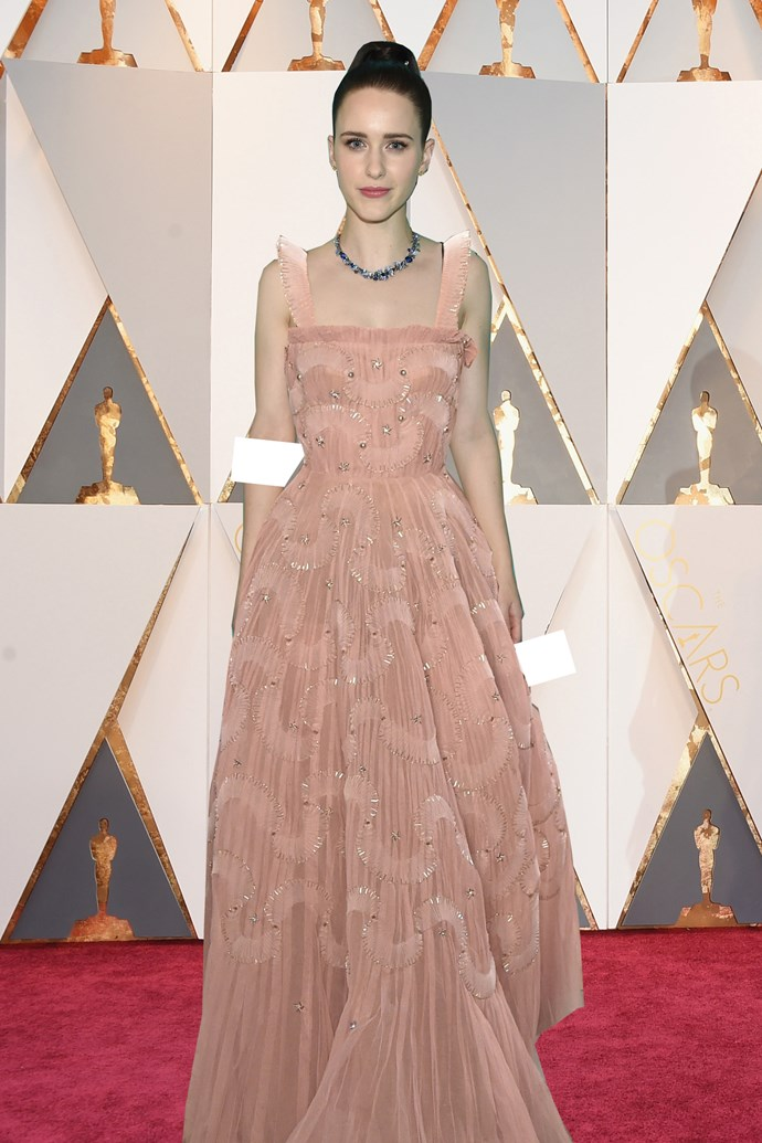 ***Rachel Brosnahan in Christian Dior***<br><br> After flitting between Prada and Miu Miu, we think Rachel would go for a classic ball gown moment for the Oscars. This delicate Dior piece in pale peach is stunning.