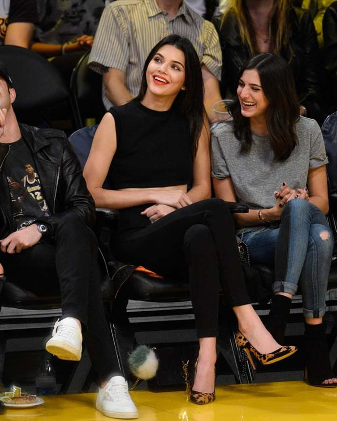 In a black ensemble and animal print pumps to watch the Dallas Mavericks and the Los Angeles Lakers play on November 1st, 2015.