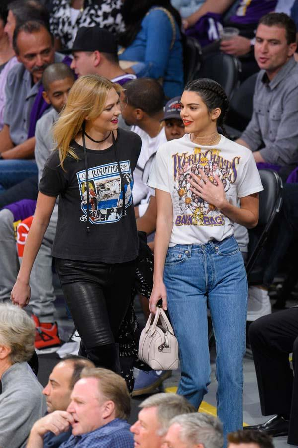 In a vintage Lakers tee and jeans to watch the Houston Rockets and the Los Angeles Lakers play on October 26th, 2016.