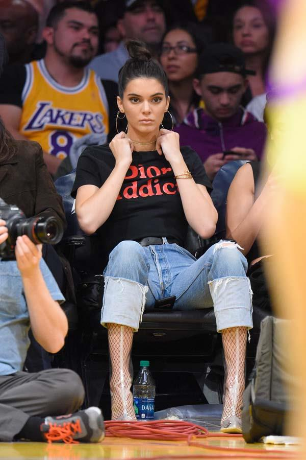 In a vintage Dior tee and PVC boots to watch the Memphis Grizzlies and the Los Angeles Lakers play on January 3rd, 2017.