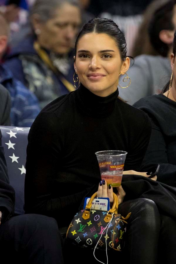 In a black turtleneck and mini Louis Vuitton bag to watch the San Antonio Spurs and Philadelphia 76ers play on January 23rd, 2019.