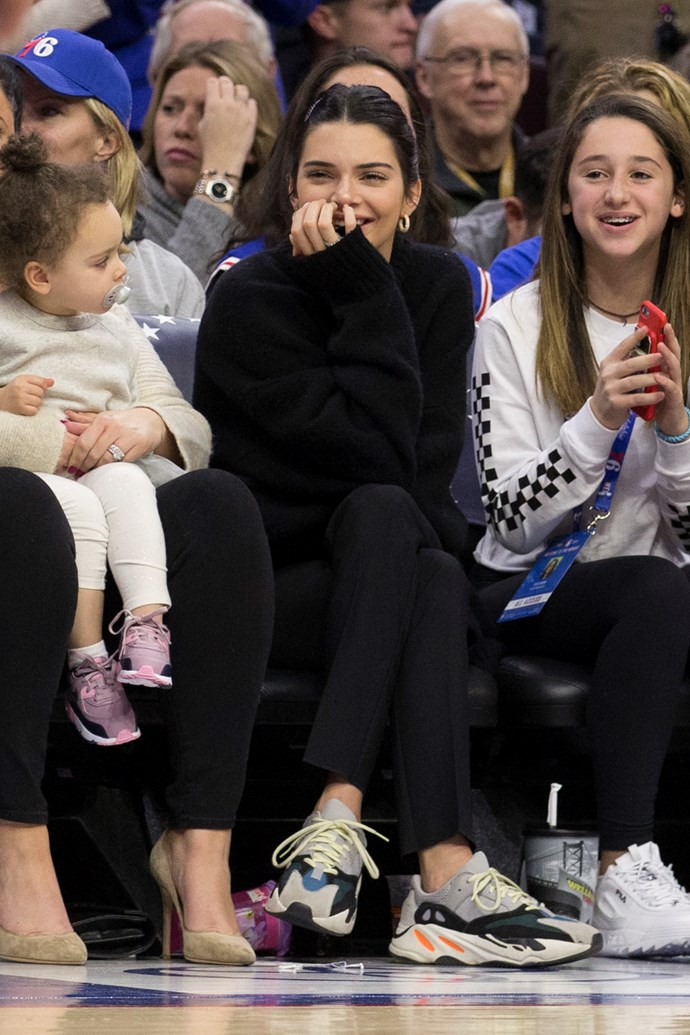In a black ensemble and Balenciaga sneakers to watch the Cleveland Cavaliers and Philadelphia 76ers play on November 23rd, 2018.