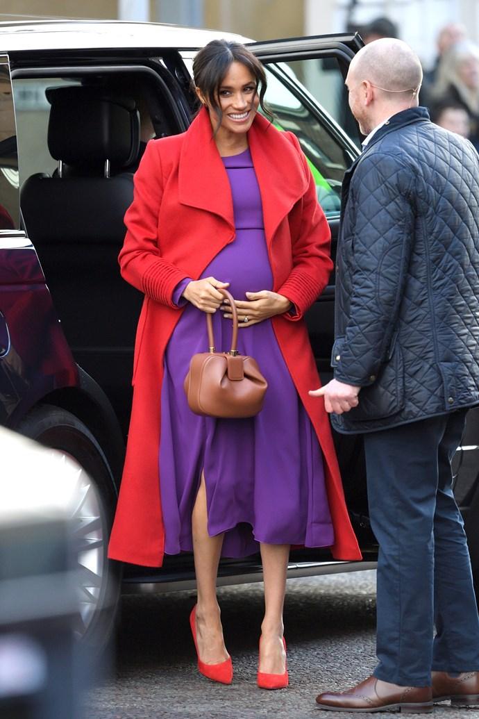 In an Aritzia dress and Sentaler coat on January 14, 2019.