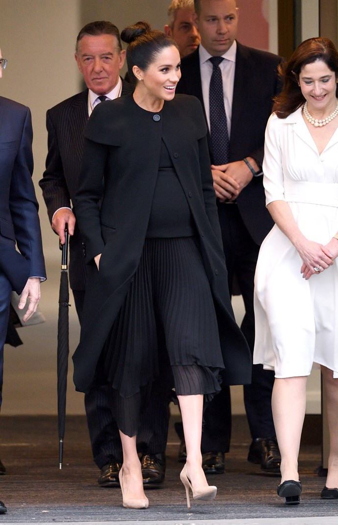 In a bespoke Givenchy dress and coat on January 30, 2019.