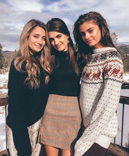 Taylor Hill with her lookalike sisters, Logan Rae (left) and Mackinley (centre).