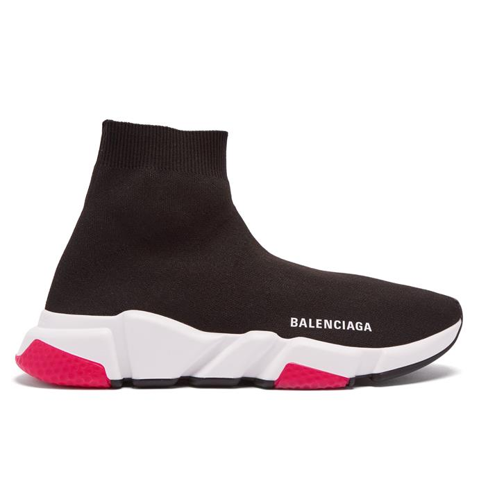"***#3: Balenciaga 'Speed' Sneakers*** <br> Whether or not you're a fan, you can't deny Balenciaga's cult classic 'Speed' sneakers were *everywhere* in 2018. As one of the brand's more affordable styles, they're also much more agile than the much chunkier 'Triple S' sneakers. <br><br> *Balenciaga 'Speed' sneakers, $885 at [MATCHESFASHION](https://www.matchesfashion.com/au/products/Balenciaga-Speed-high-top-sock-trainers-1232130|target=""_blank""