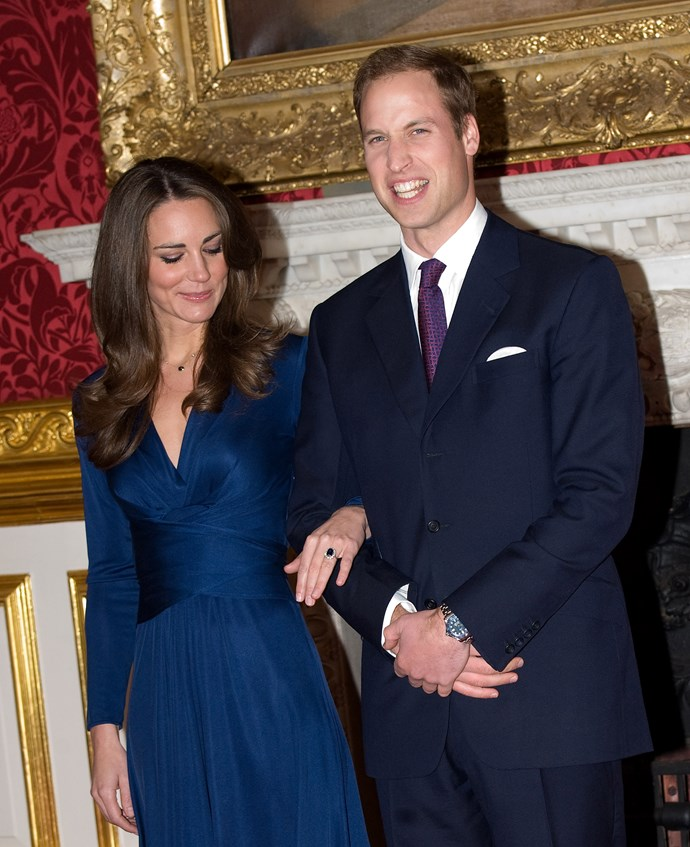 Admiring her engagement ring from Prince William in 2010.