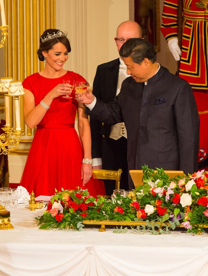 Raising a glass with Chinese President Xi Jinping in 2015.