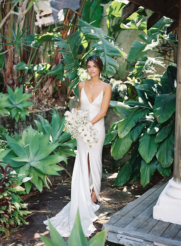 **On finding the dress:** It is not an easy task to find a gown that is beautifully simple and luxurious at the same time. This gown had it all, it fitted perfectly and the silk draped effortlessly highlighting Romi's slim curves. Most importantly she felt really comfortable wearing it as it allowed her to move and really feel free on that hot summer's day. It's one of those gowns that translates beautifully in every setting and is very versatile.