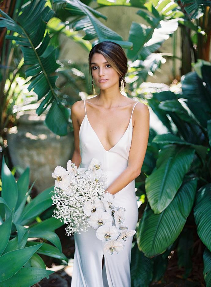 **Was there an outfit change for the reception?** No in keeping with them wanting to spend as little time rushing around changing and getting ready they instead opted for a gown and suit that would perfectly translate from the ceremony to the lunch reception.