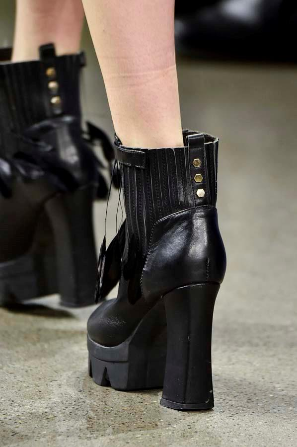 ***Thy Shalt Pick A Strong Boot***<br><br> Flat or heeled, a utilitarian boot is the chicest way to stomp into winter. Buckled down, laced up and made for your trudge through puddles to the train stop, a good pair will toughen up any look. <br><br> Pictured: Taoray Wang autumn/winter '19.