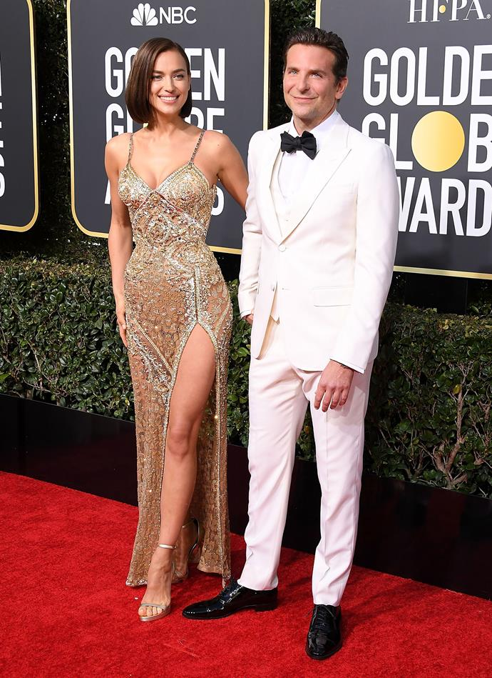***January 6, 2019*** <br> While Cooper wore a white Gucci tuxedo at the 2019 Golden Globes, it was hard to see past Shayk's glimmering Atelier Versace dress, which fit her like a glove.