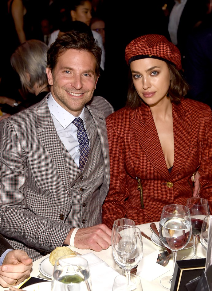 ***January 8, 2019*** <br> For the National Board of Review Annual Awards Gala in New York, Cooper and Shayk wore the same checked pattern—his an all-grey dinner suit, and hers a crimson blazer-dress from Versace resort '19 (matching beret included).