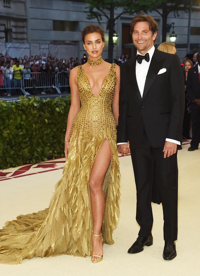 ***May 7, 2018*** <br> At the 2018 Met Gala, Shayk wore a feather-detail Atelier Versace gown, while Cooper played it safe in a tuxedo.