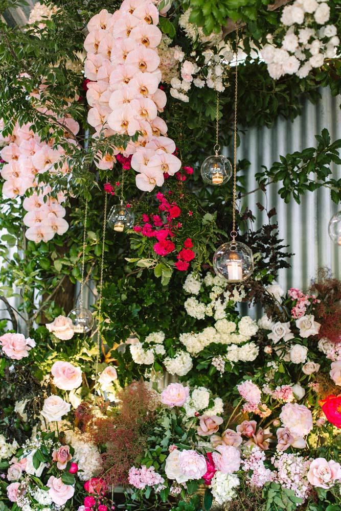 **On the flowers:** Rebecca Grace from Natural Art turned our reception shed into a romantic, enchanted forest—it was bursting with hundreds of flowers and candles. Flowers climbed up posts and spilled down the walls. A large branch was suspended from the ceiling and dripped with peonies, hydrangeas, orchids and roses in white and shades of pink. It was stunning. To compliment the scent of all those roses, I chose Giambattista Valli x Cire Trvdon Rose Poirvree as the scent of the wedding and filled the reception with these candles. Whenever I burn one it instantly takes me back to our wedding day.