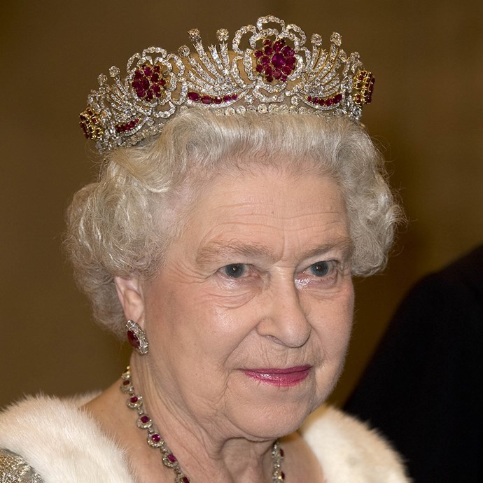 **The tiara:** The Burmese Ruby Tiara.<br><br> **The history:** This tiara was commissioned by Queen Elizabeth II in 1973 using rubies and diamonds taken from dismantled tiaras and necklaces. It has a distinctive floral pattern.<br><br> **The current wearer:** Queen Elizabeth II.<br><br>