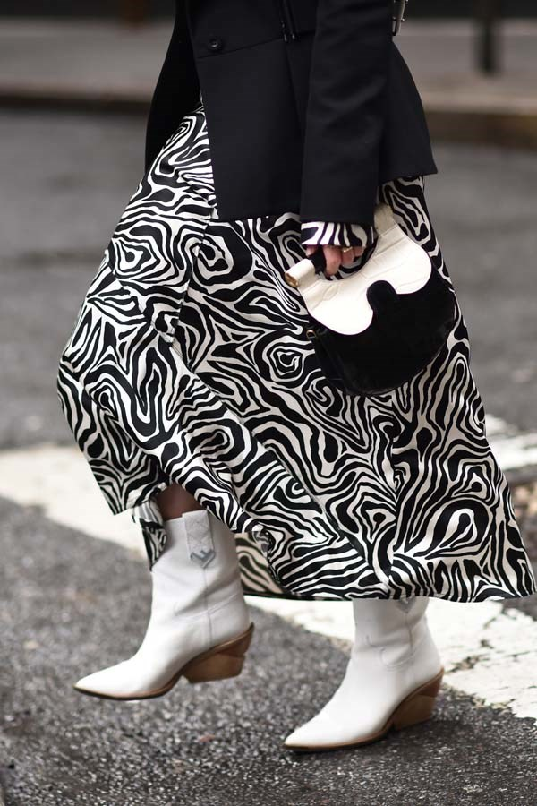 *White Boots*<br><br> Keep your feet warm and stylish at the same time (but don't forget to avoid rain puddles).