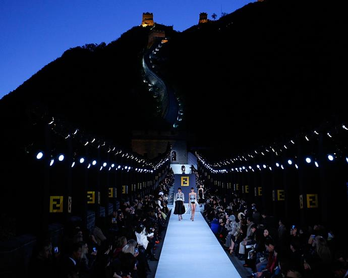 ***Fendi autumn/winter '08*** <br><br> Almost ten years before he showed at the Trevi Fountain in Rome, Lagerfeld employed one of the world's most famous landmarks for Fendi autumn 2008—the Great Wall of China. Don't think it came cheaply, either—it reportedly cost the house U.S. $10 million to stage the show without a hitch.