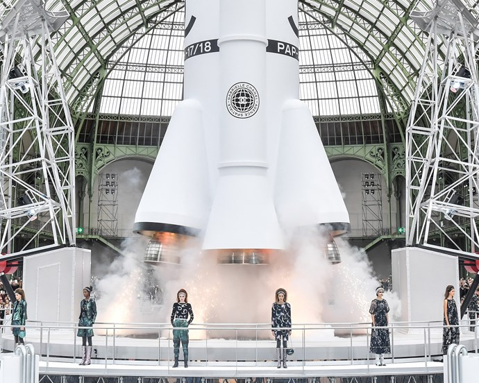 ***Chanel autumn/winter '17*** <br><br> Harking back to the mid-century Space Age, Chanel made a rocket-ship the centrepiece of their autumn 2017 show—which lit its turbines and took off after the runway presentation concluded.