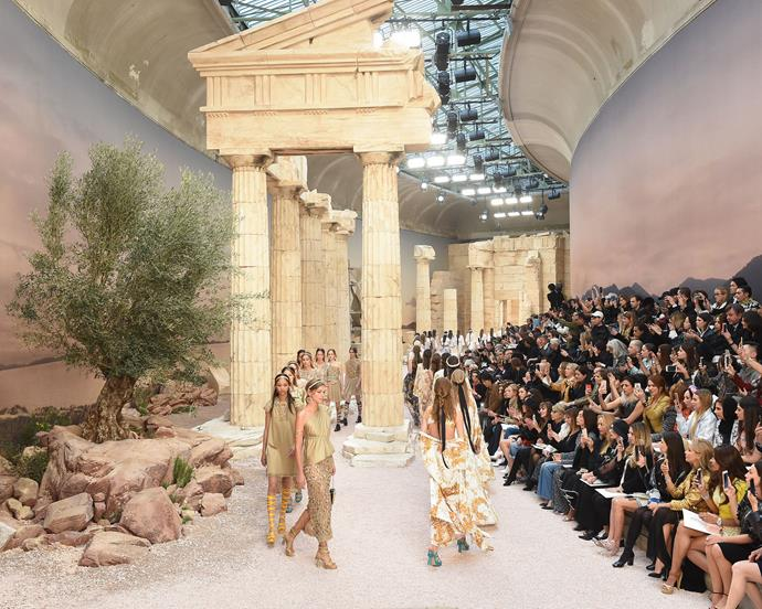 ***Chanel Cruise '18*** <br><br> Lagerfeld infused the set of Chanel's Cruise 2018 show with replicas of Ancient Greek relics, which perfectly coordinated with the models' Grecian-themed garments.