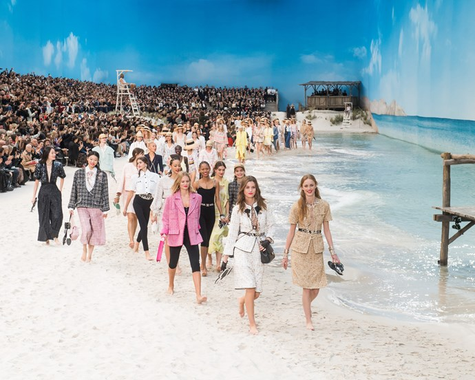 ***Chanel spring/summer '19*** <br><br> Chanel spring/summer '19 saw the Grand Palais receive perhaps its most ambitious transformation yet—becoming a stunning beach, with real sand and surprisingly convincing waves. It was also the final Chanel show that Lagerfeld would ever take his bow at.