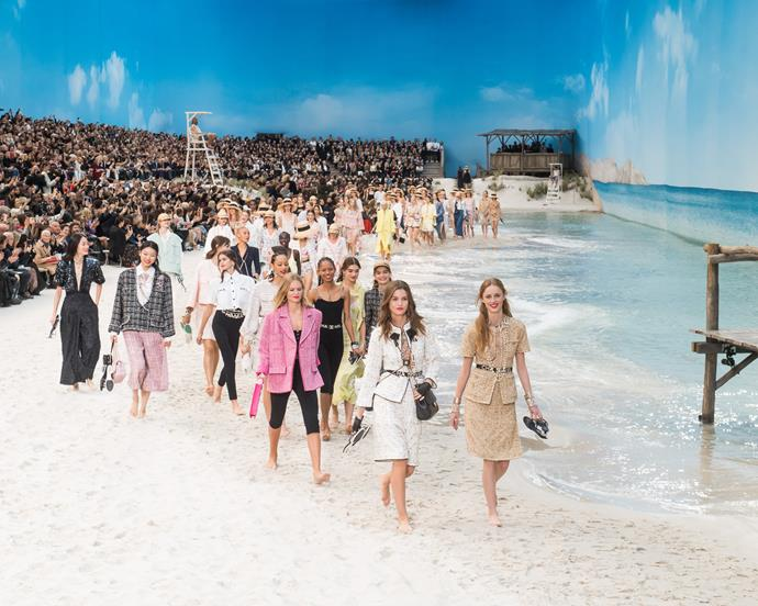 ***Chanel spring/summer '19*** <br><br> Chanel spring/summer '19 saw the Grand Palais receive perhaps its most ambitious makeover yet—becoming a stunning beach, with real sand and tropical island-style waves. It was also the final Chanel show that Lagerfeld would ever appear at.