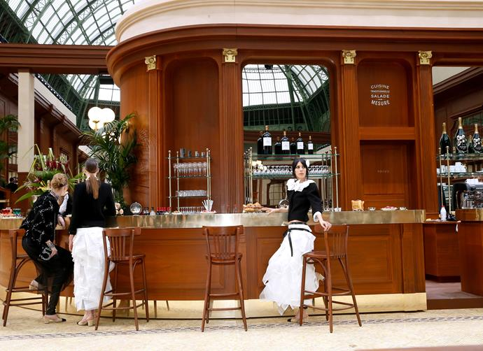 ***Chanel autumn/winter '15*** <br><br> The Grand Palais became one of Paris' most beautiful brasseries (complete with stunning tiled floors and plenty of waiters on hand) for Chanel's autumn 2015 show. Lagerfeld even came out and took a seat at the bar when the show concluded.