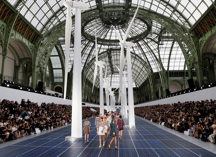 ***Chanel spring/summer '13*** <br><br> Lagerfeld delved into the world of sustainable energy for his spring/summer '13 show by turning the runway into a giant solar panel—and planted monolithic wind turbines in the middle of the runway.