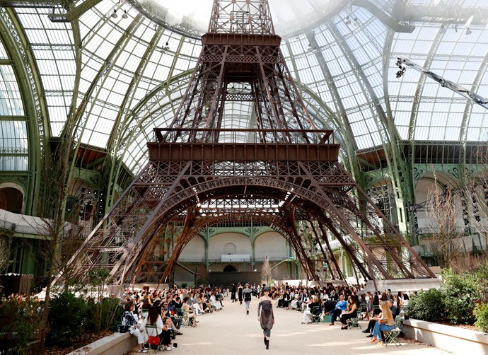 ***Chanel Haute Couture autumn/winter '17*** <br><br> When we thought the rocket-ship couldn't be topped, Lagerfeld took his visions to new heights (no pun intended) by constructing an almost life-size Eiffel Tower inside the Grand Palais. Sure, the real thing is only a few moments' drive away, but why bother visiting when you can construct the same thing indoors, with low-lying fog included?