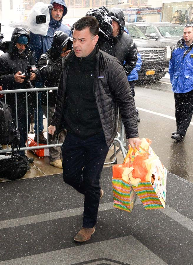 A member of staff carrying gifts.