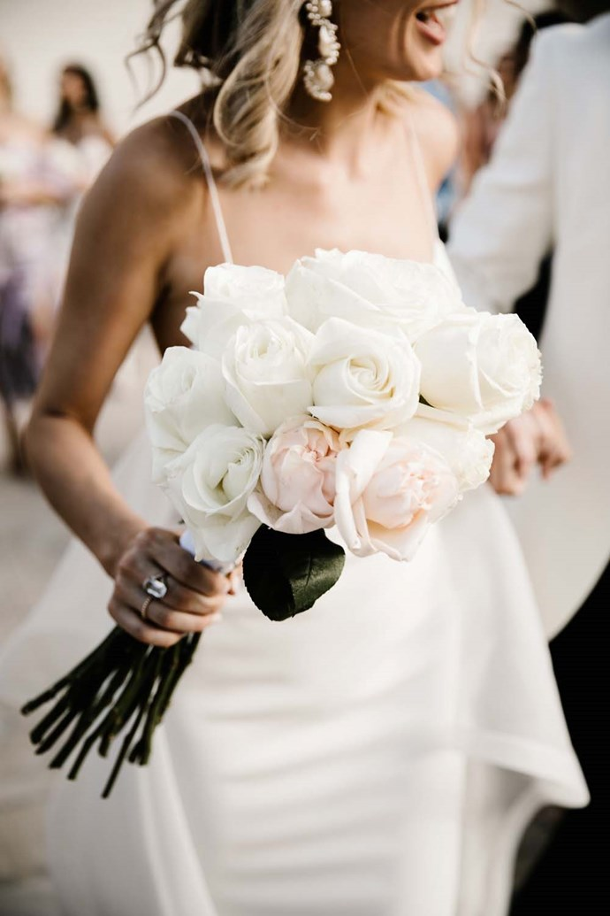 **On the bouquet:** We chose large white Colombian roses for the bouquets. I wanted to keep it minimal and timeless as I had such a large bride-tribe and knew they would all be wearing a variety of gowns.