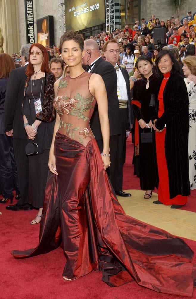 """***Halle Berry in Elie Saab, 2002***<br><br> At the 2002 Oscars, Best Actress nominee Halle Berry wore this mesh-and-silk Elie Saab gown, that *Variety* notes had """"fashion critics raving for days""""."""